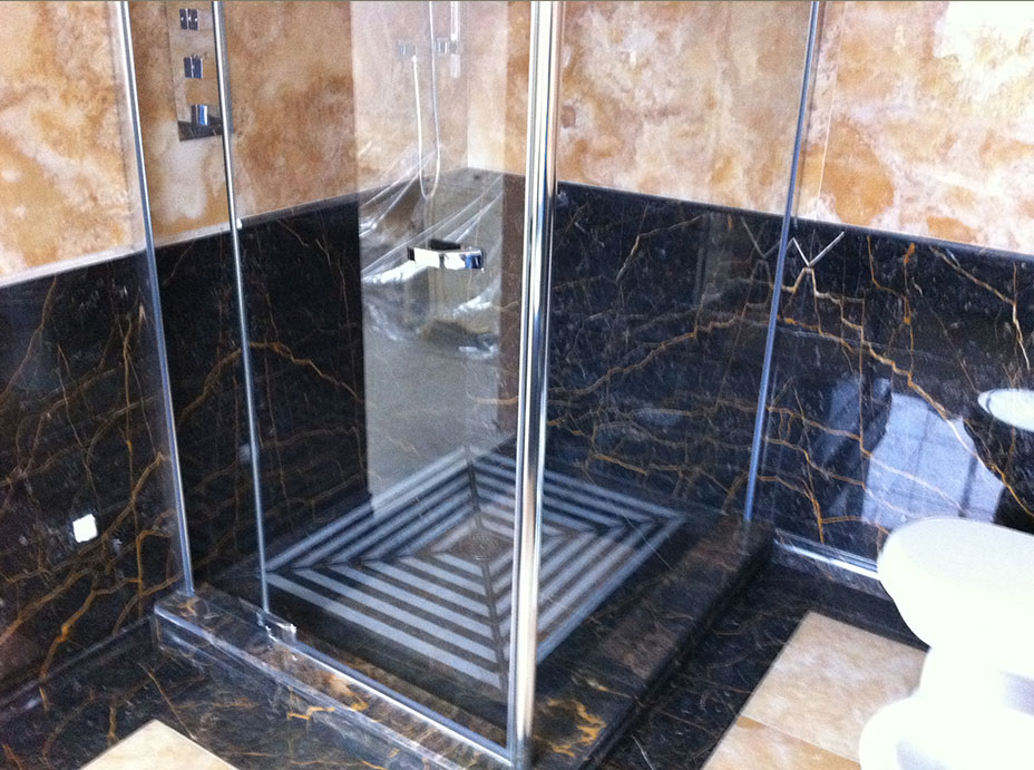 Bathroom in Gold Onyx and Port St Laurent Marble