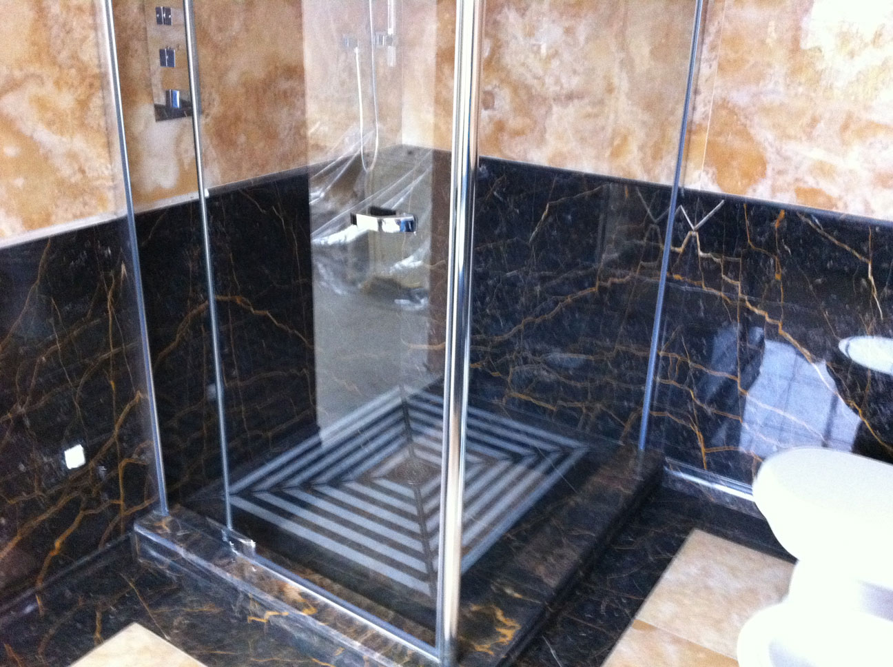 Bathroom in Gold Onyx and Port St Laurent Marble1